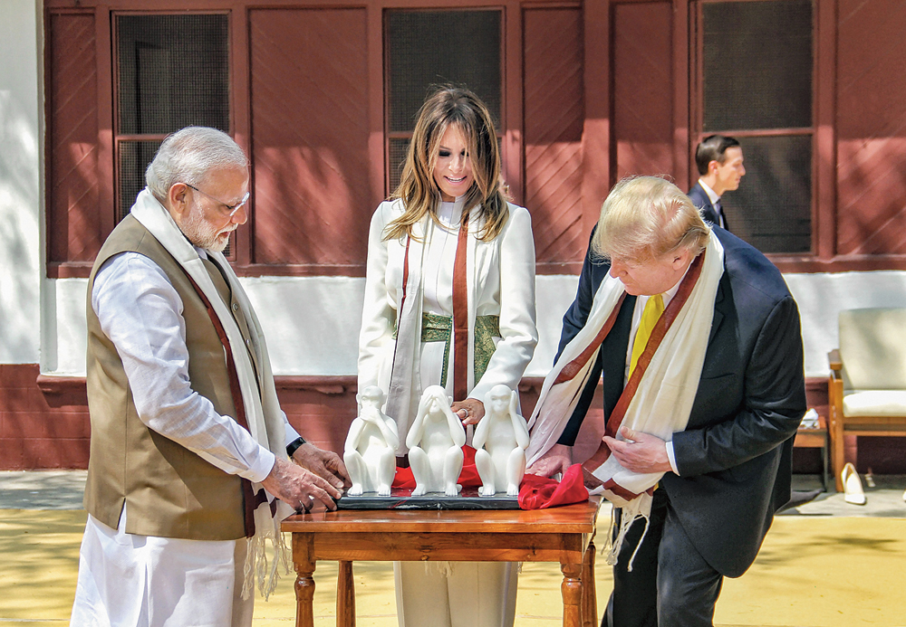 The US President being gifted a memento 'Three Wise Monkeys' at the Ahmedabad ashram