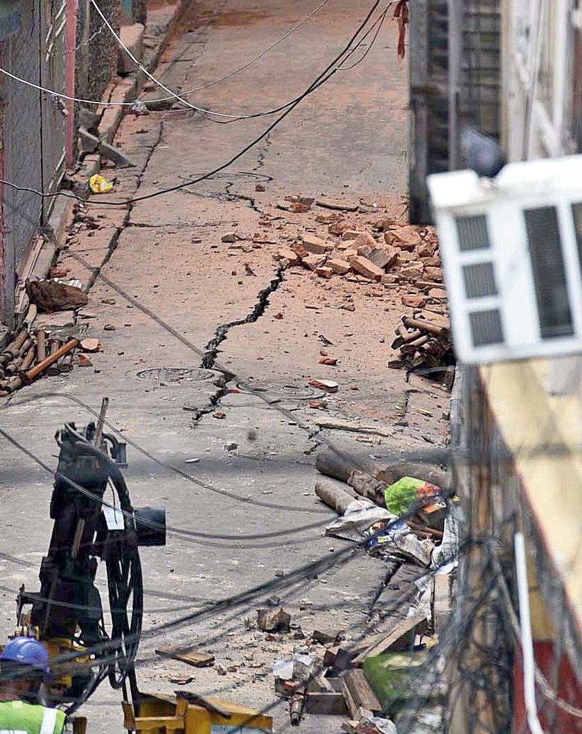 A crack in Durga Pituri Lane in Bowbazar.