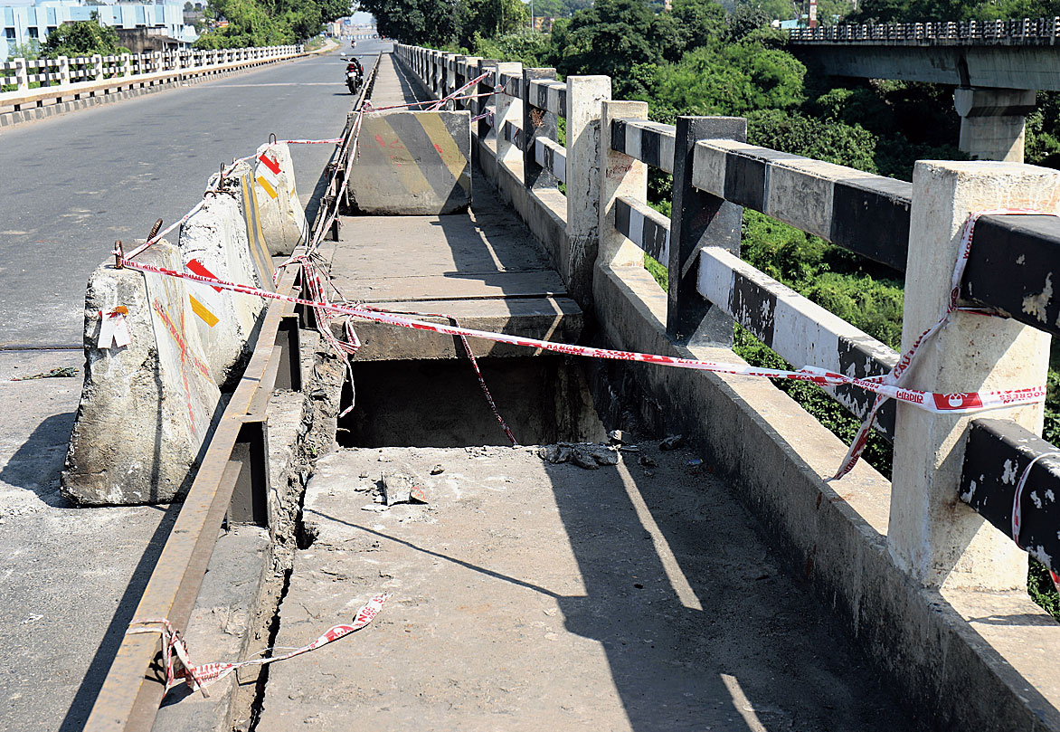 The yawning gap formed after two concrete slabs fell from the footpath of the bridge.