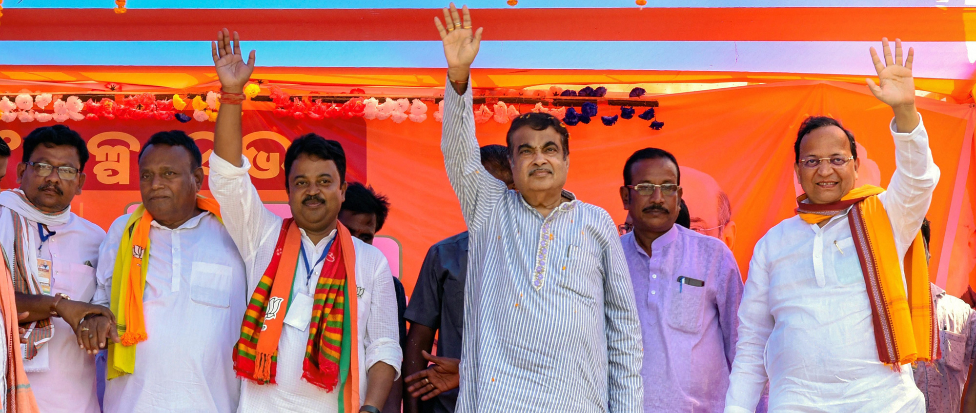 Union minister and BJP leader Nitin Gadkari along with party leaders waves at supporters during an election campaign meeting in support of the party candidates, at Barahpur, Bhadrak on Wednesday, April 24, 2019.