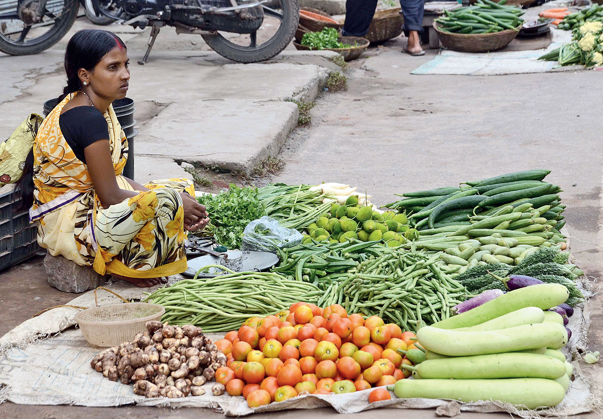 A woman sells vegetables at a market in Lalpur, Ranchi, on Wednesday.
