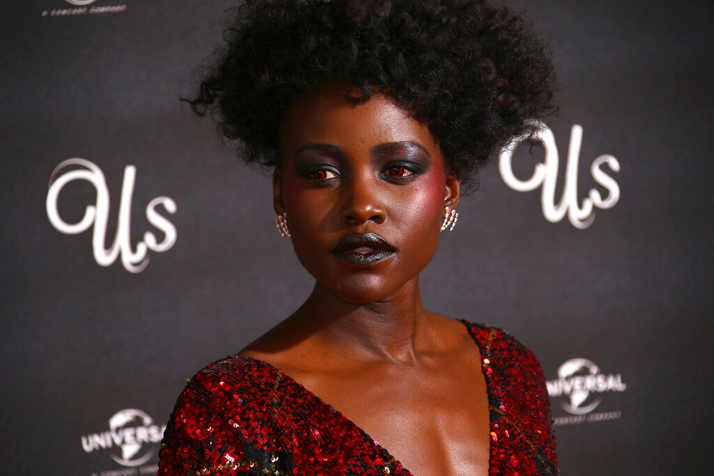 Lupita Nyong'o poses for photographers at the premiere of 'Us' in London on March 14, 2019