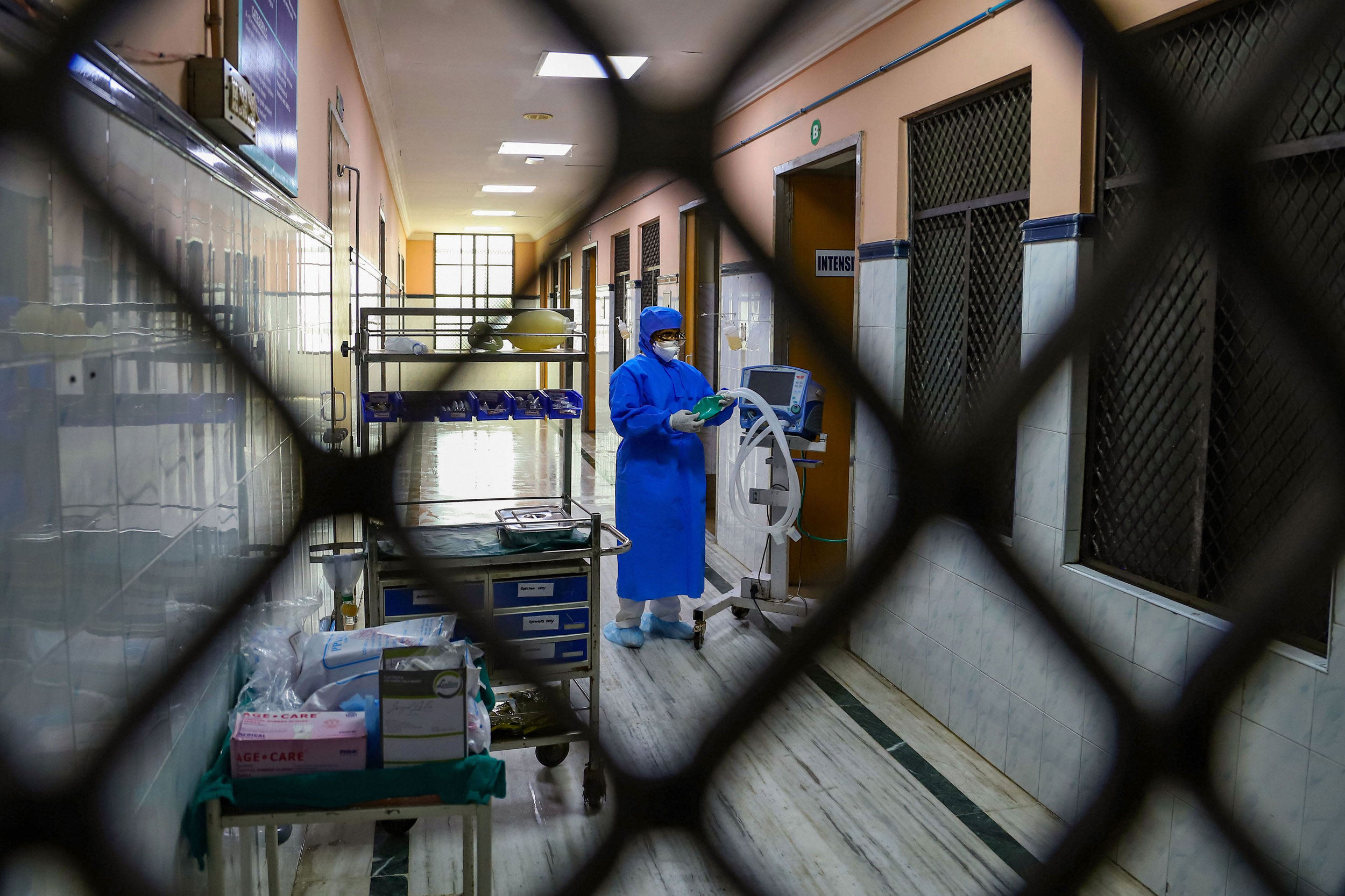 Hospital staff is seen outside the Special Isolation Ward set up to provide treatment to any suspected case of the coronavirus at the Rajiv Gandhi Government General Hospital in Chennai