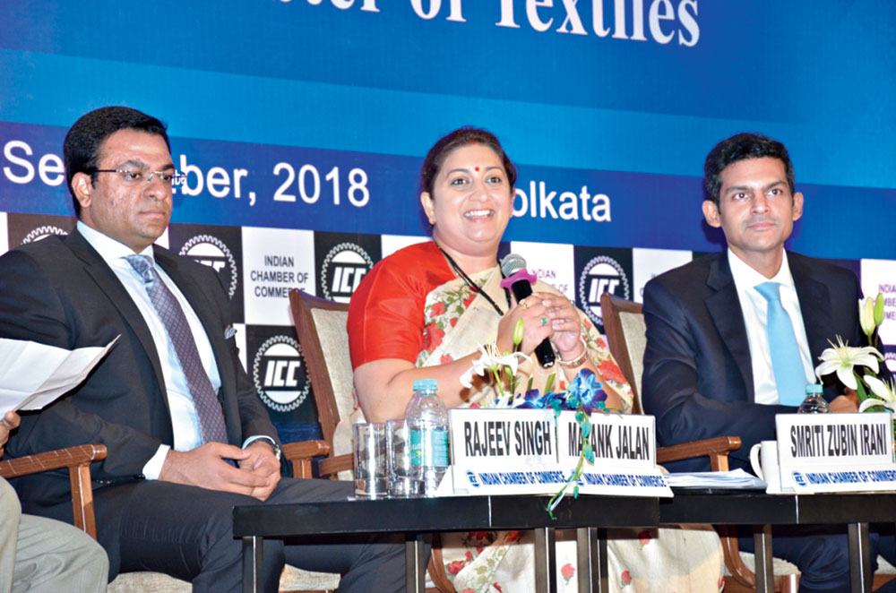Smriti Irani with Indian Chamber of Commerce president Rudra Chatterjee (right) and senior vice-president Mayank Jalan in Calcutta on Saturday.