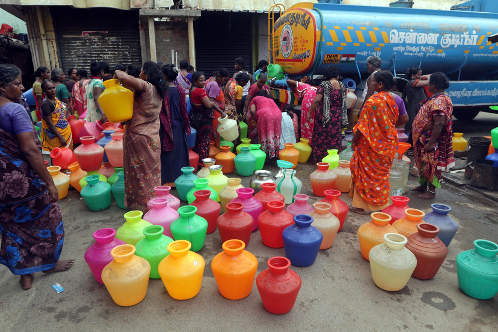 Chennai residents queue up to collect water from a tanker. 'At Nature's Edge' comes as a sombre reminder of the fact that alarmist responses are seldom productive