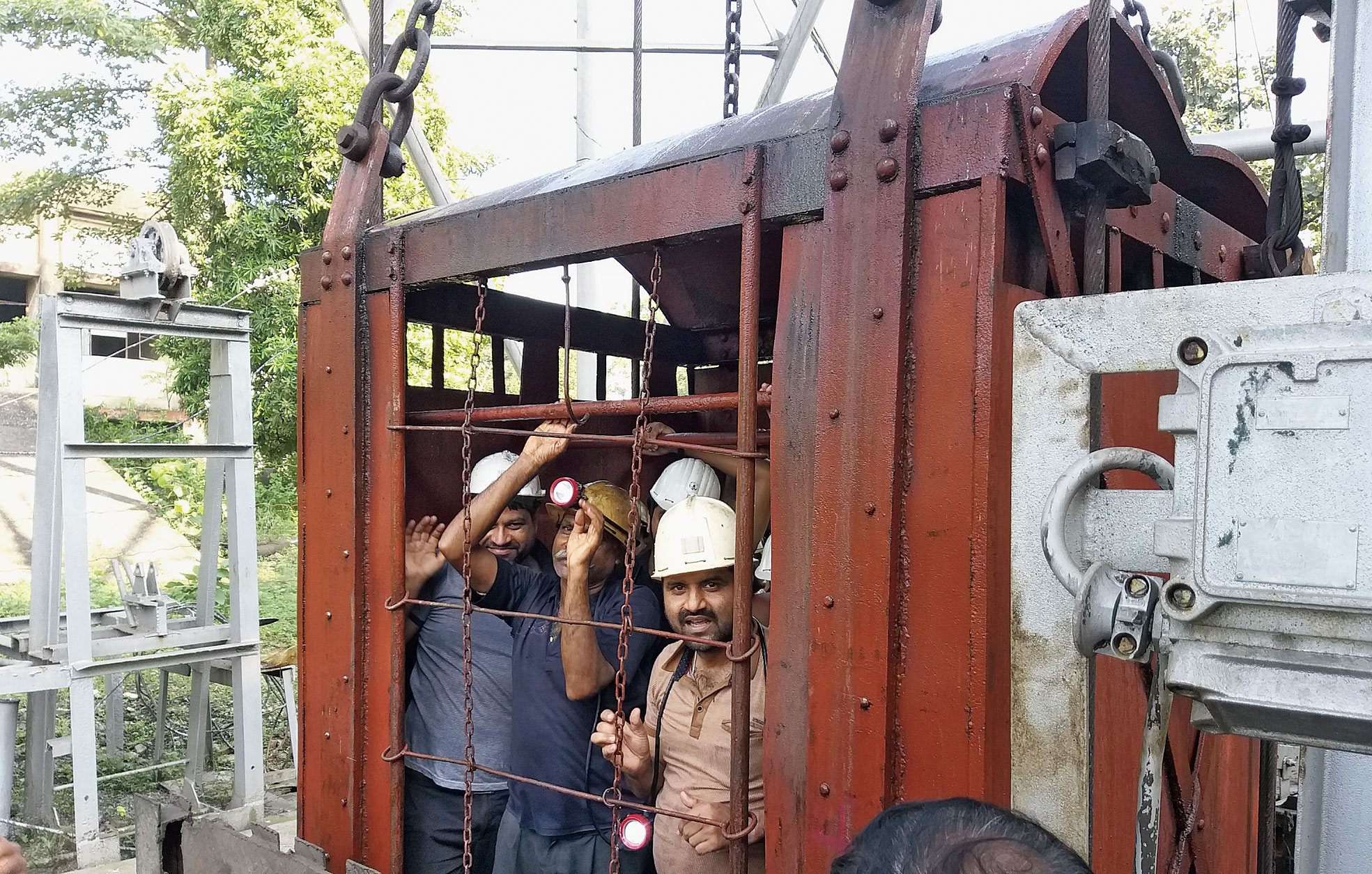 Trapped miners come out of BCCL's Putki Balihari colliery in Dhanbad on Sunday.