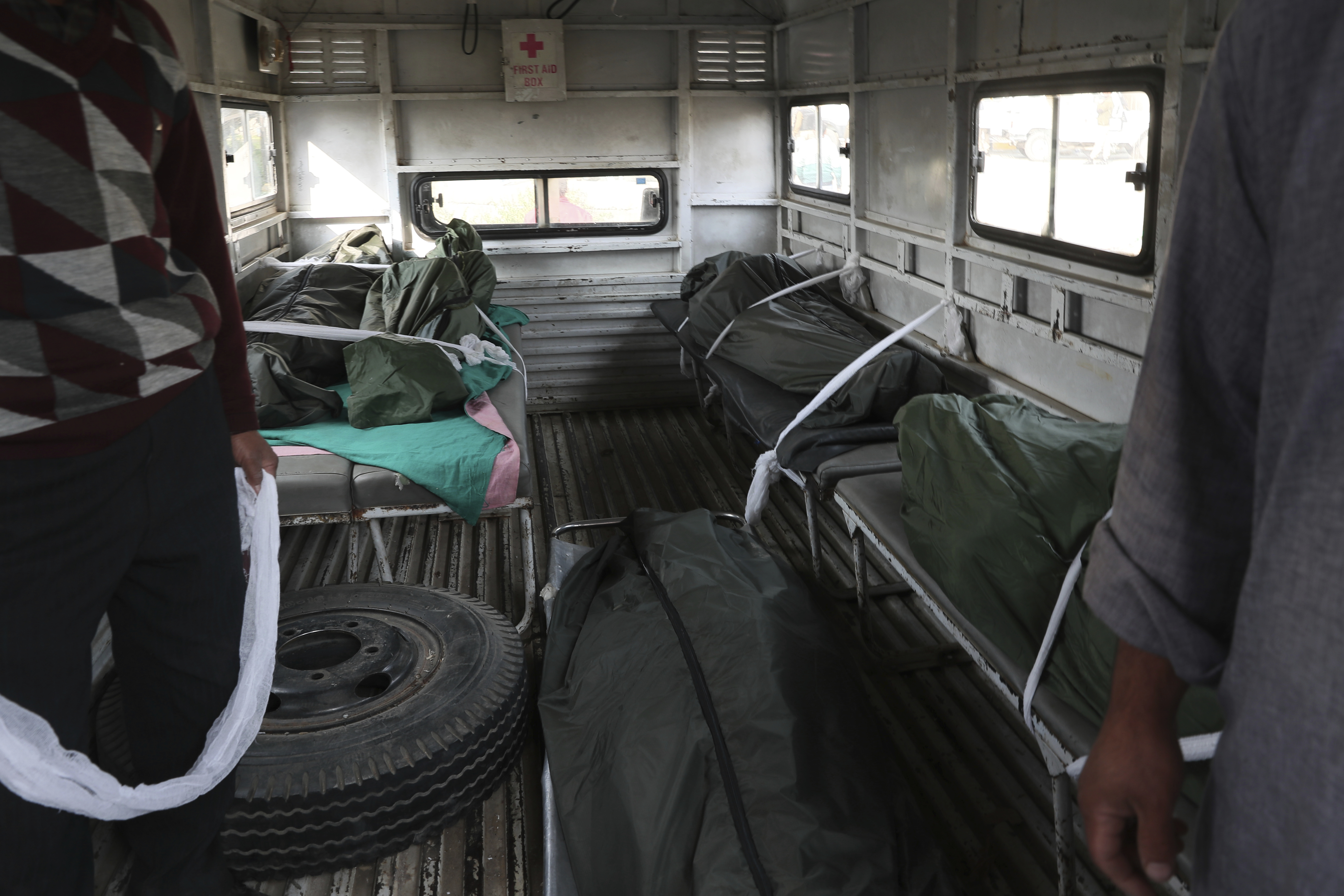 Bodies of Indian laborers who were shot dead by gunmen are seen inside an ambulance outside a hospital in Kulgam on October 30, 2019