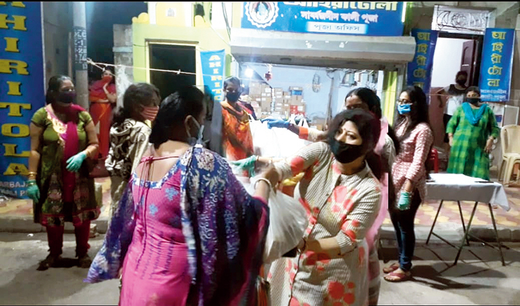 The all-women team distributes food packets in Ahiritola