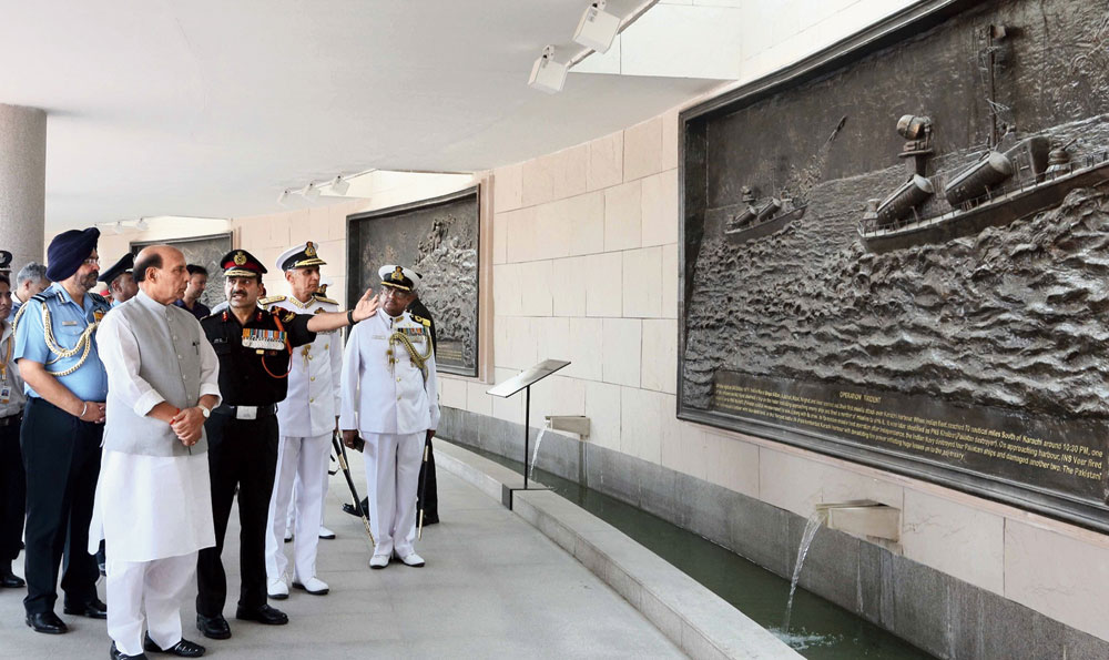 Rajnath Singh sees the murals depicting famous battles at the National War Memorial in New Delhi