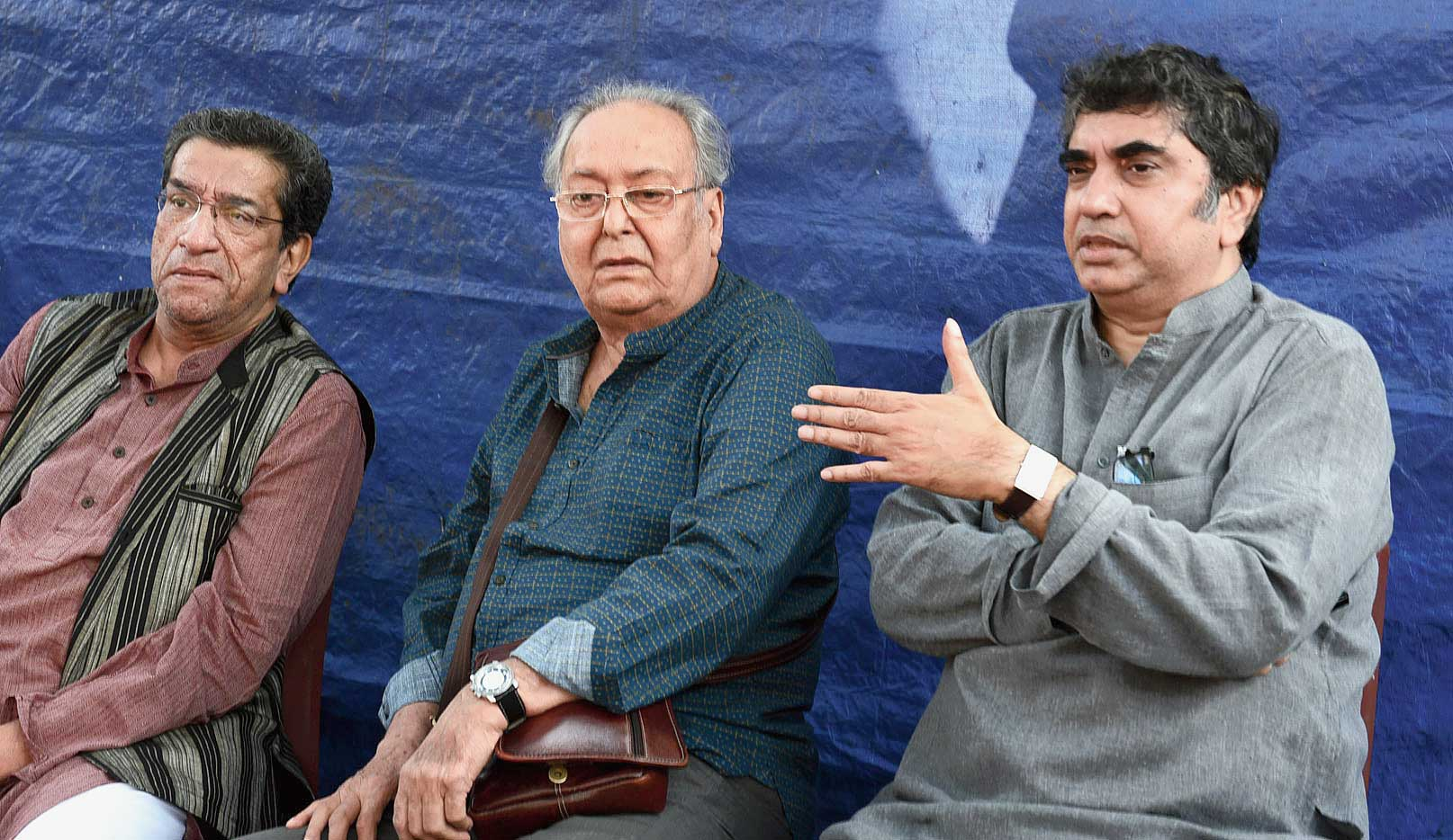 (From left) Actor Sabyasachi Chakraborty and Soumitra Chatterjee and film-maker Anik Dutta at a gathering on Tuesday to protest the pulling out of Dutta's Bhobishyoter Bhoot.