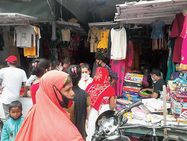 Shoppers in Dhubri on Tuesday.