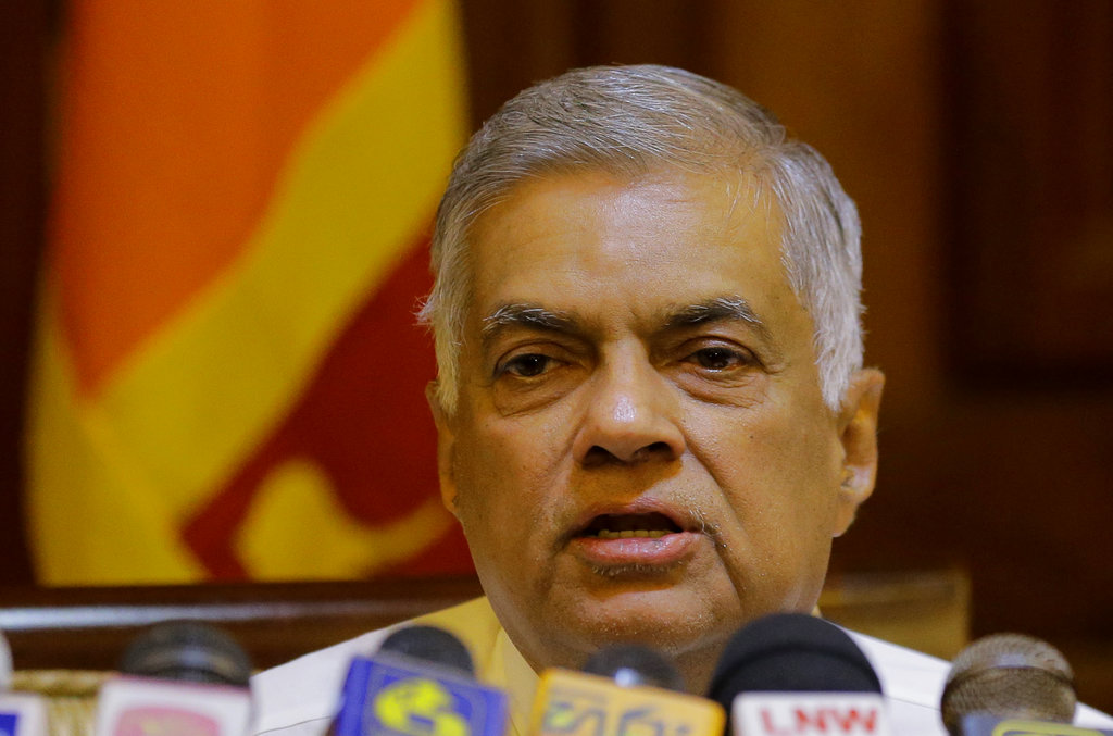 Ousted Sri Lankan Prime Minister Ranil Wickremesinghe speaks during a media briefing in Colombo on December 4, 2018.