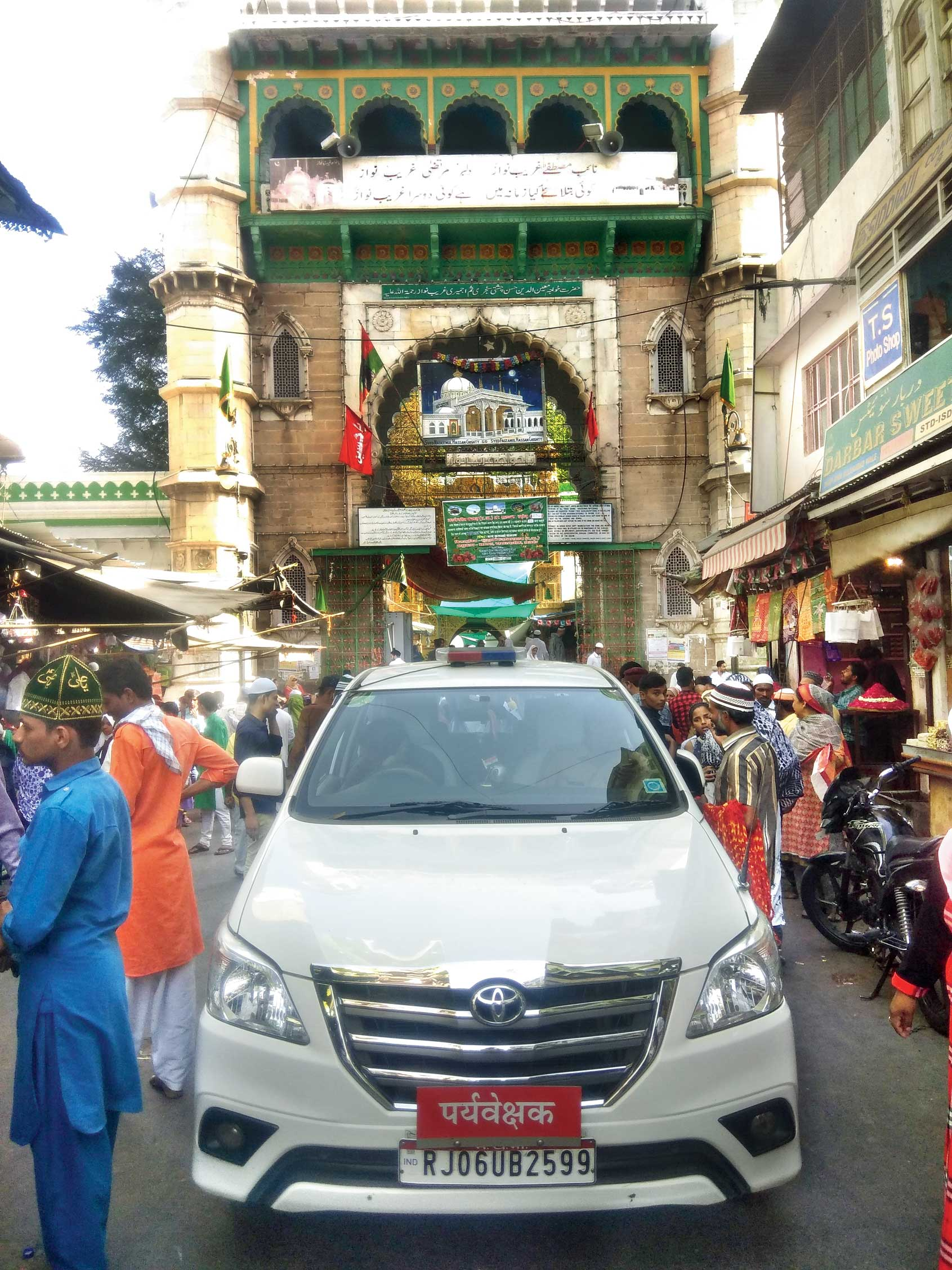 The election observer's SUV parked in the middle of the lane leading to the Ajmer dargah on Friday. The observer went inside the shrine to offer prayer.