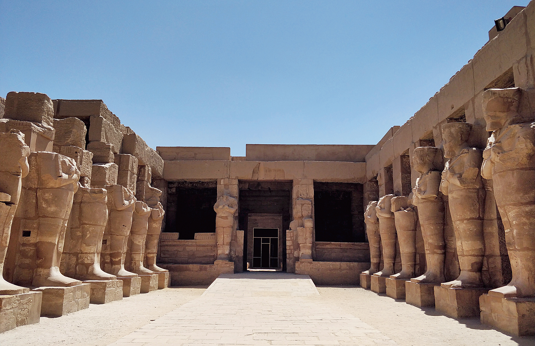 The columns and courtyard of the temple of Karnak in Luxor, which is one of the most popular tourist destinations in Egypt .
