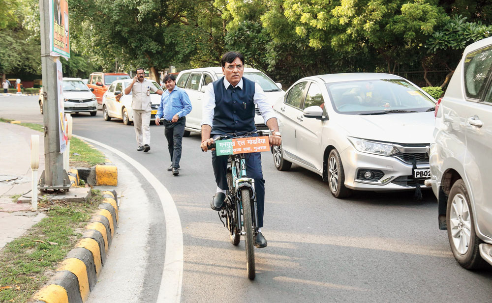 Mansukh Mandaviya, a BJP MP from Gujarat, rides a bicycle to the Rashtrapati Bhavan to attend the swearing-in ceremony of Narendra Modi