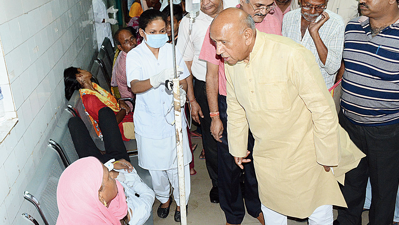Minister Saryu Roy talks to a patient at MGM Hospital in Jamshedpur on Thursday.