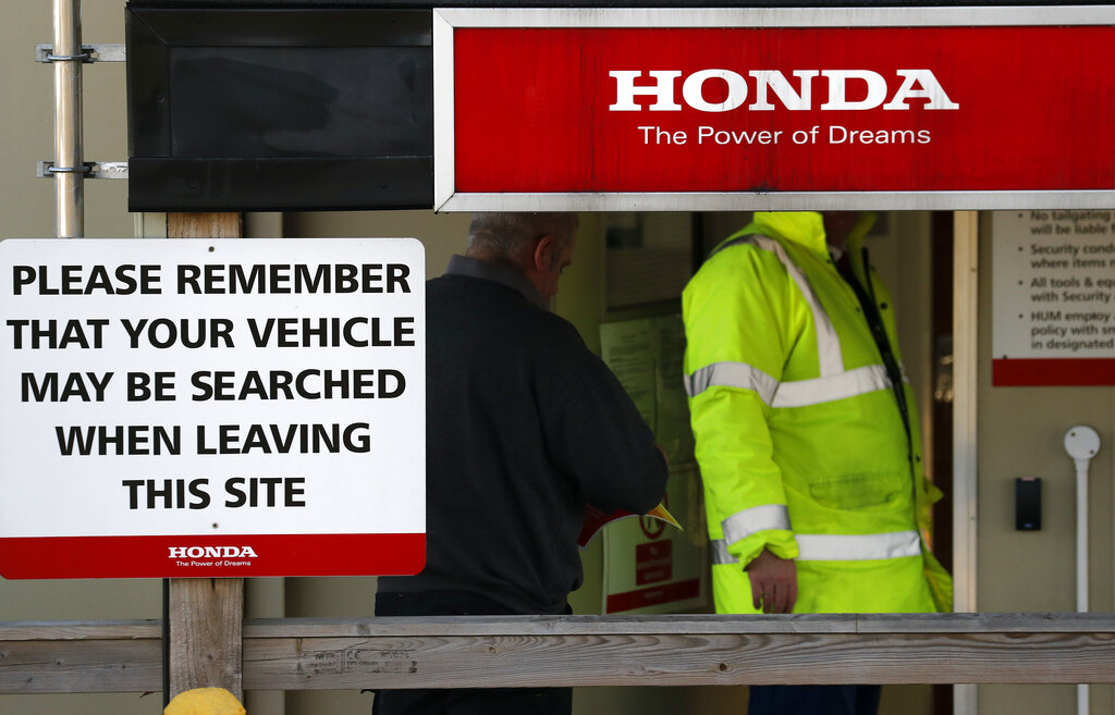 Security guards the entrance of the Honda car factory in Swindon, England, on Tuesday.