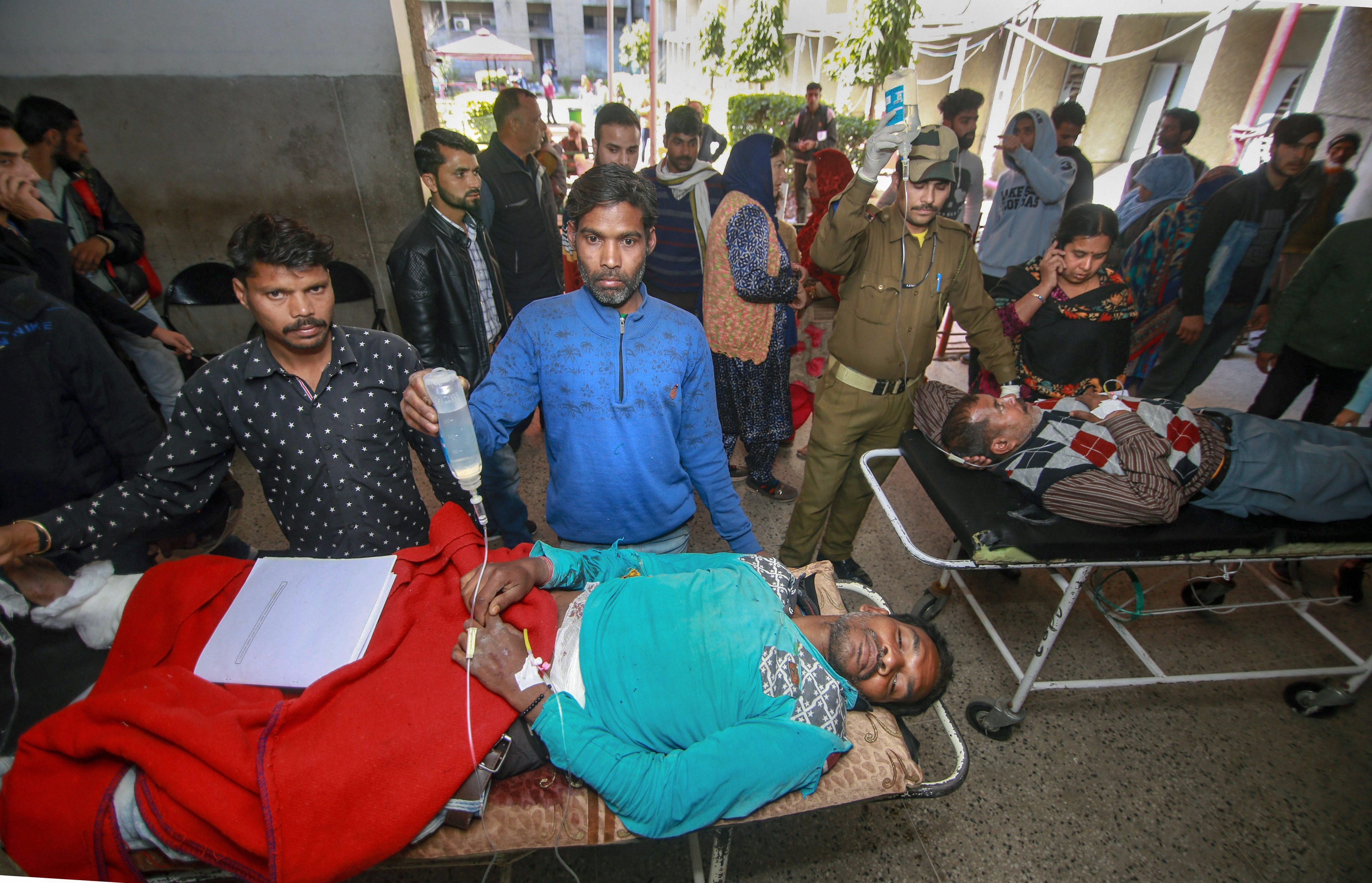 People injured in the grenade attack being brought to hospital in Jammu on Thursday.
