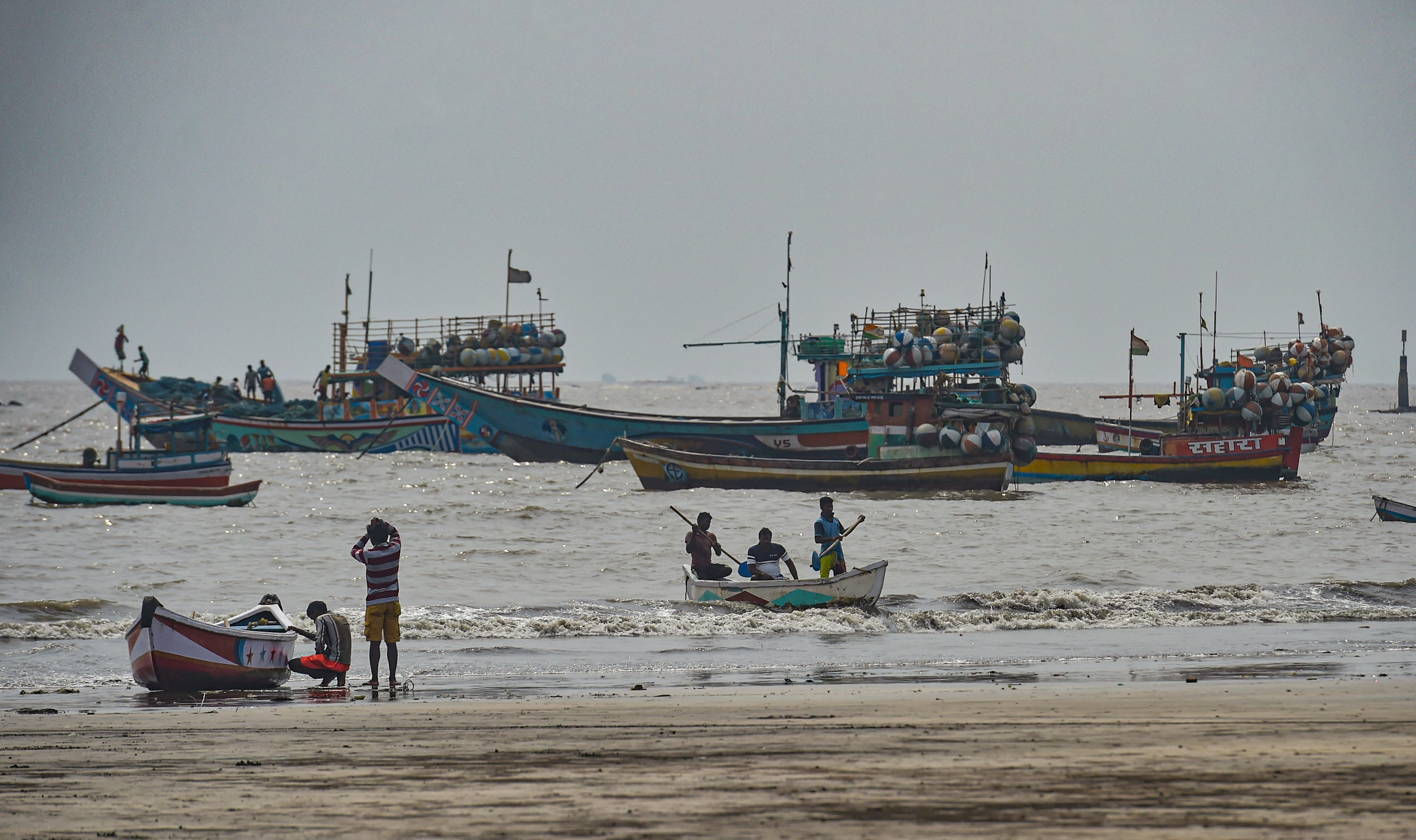 Fishing boats seen anchored at a shore following a warning by IMD for fishermen not to enter the Arabian Sea for the next two days as a precaution against cyclone Nisarga, at Uttan beach in Thane, Monday, June 1, 2020