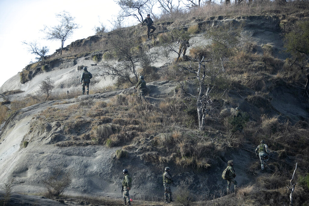 Indian security force soldiers patrol near the site of a gun-battle at Nagrota , on the outskirts of Jammu, on Friday