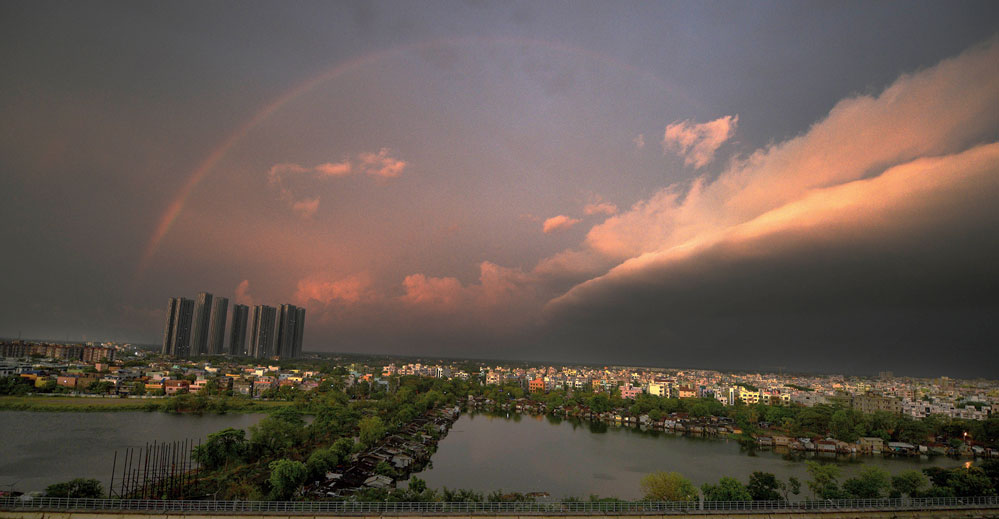 A rainbow adorns the city sky in the picture taken from the terrace of an EM Bypass highrise overlooking the East Calcutta Wetlands.
