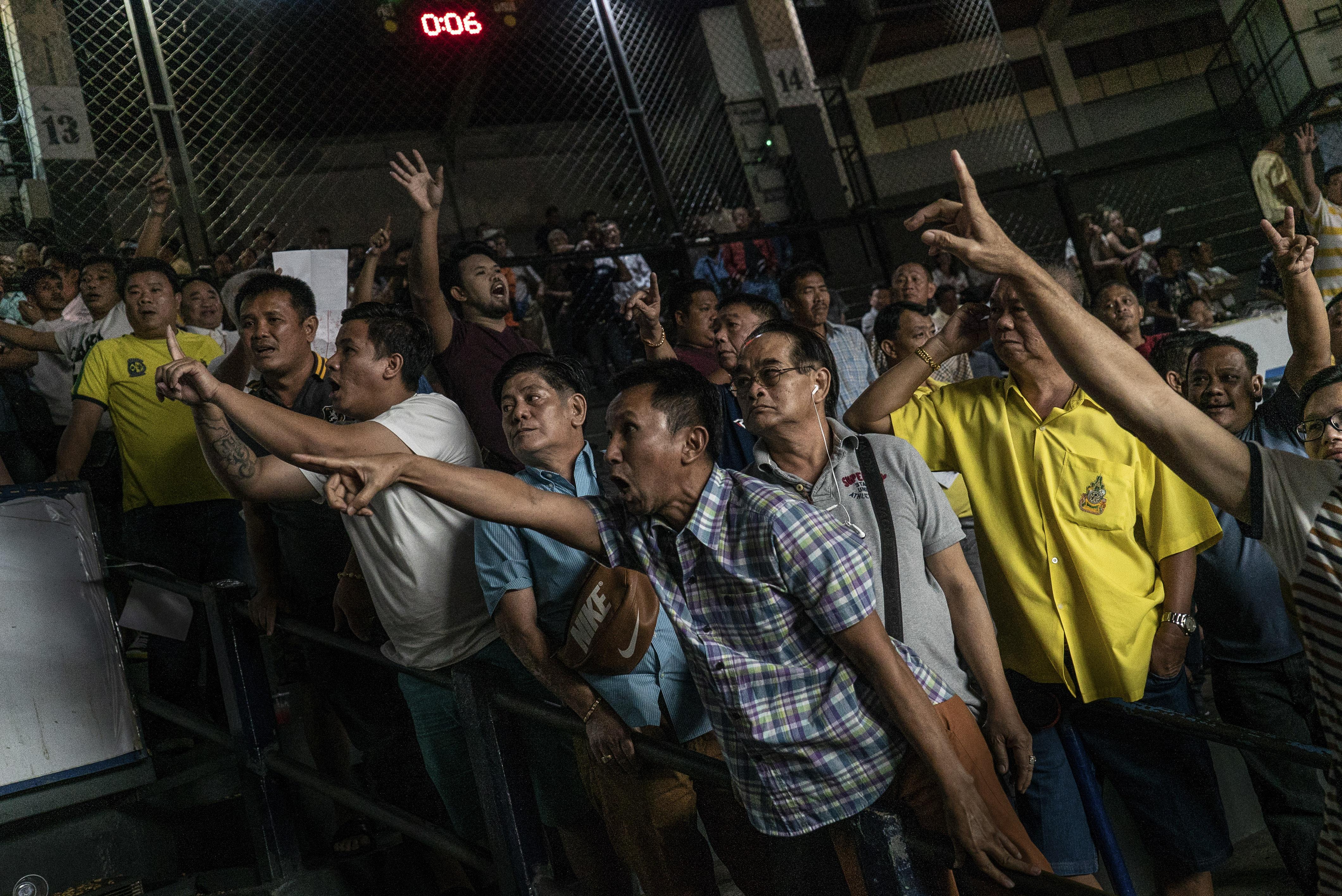 Spectators in the stands of the Rajadamnern Stadium in Bangkok.