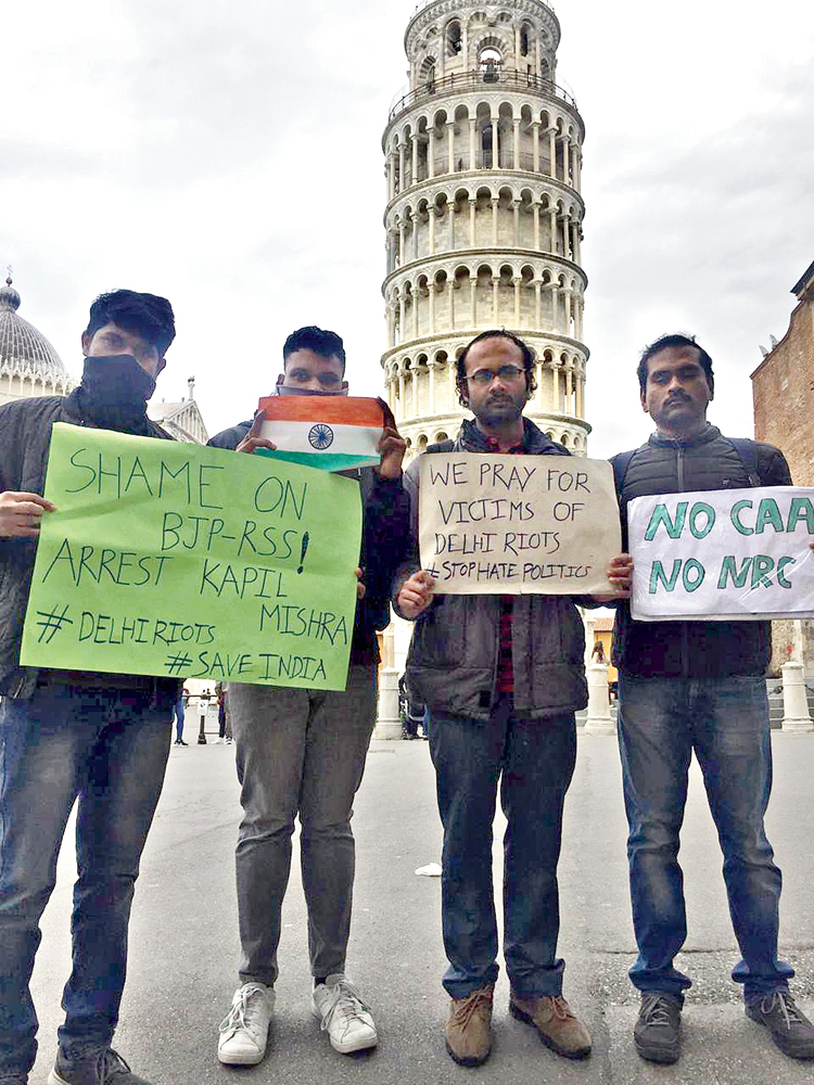 Indian in Pisa in Italy gather to condemn the violence in Delhi