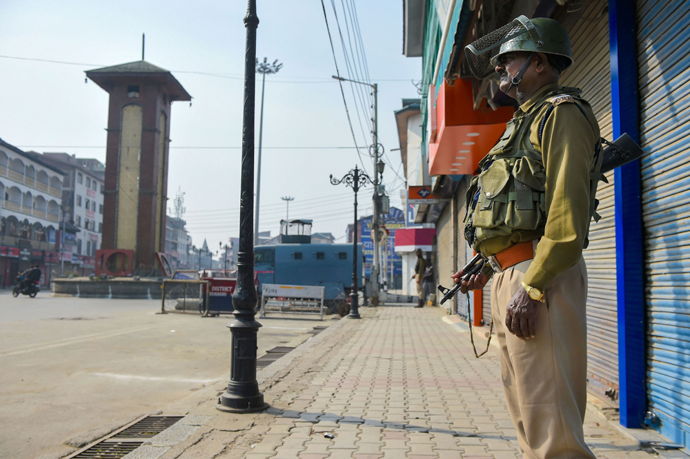 A trooper stands guard at Lal Chowk in Srinagar on Tuesday, the day of the visit by an unofficial delegation of members of the European Parliament