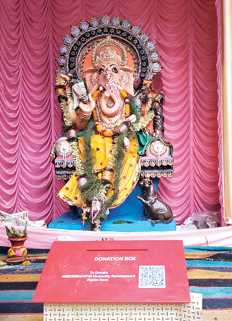 The code of a digital wallet app affixed to the donation box at a Bangur Avenue Ganesh puja.