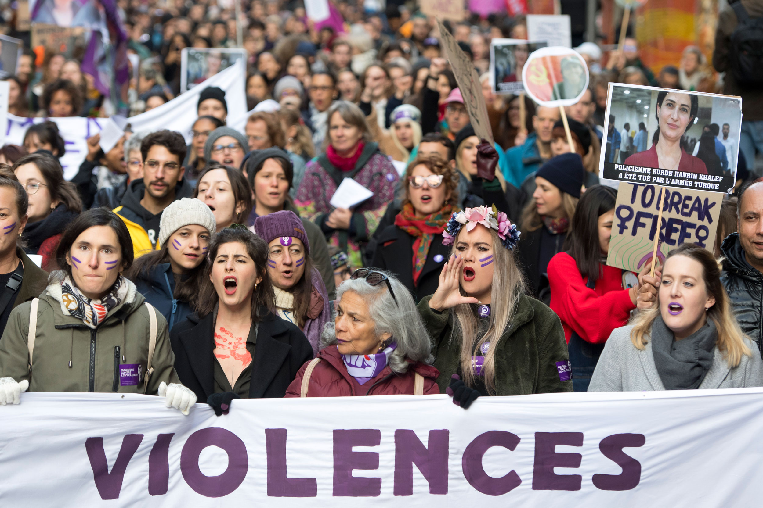 Women shout slogans during a demonstration against gender-based and sexual violence in Lausanne on November 23, 2019.