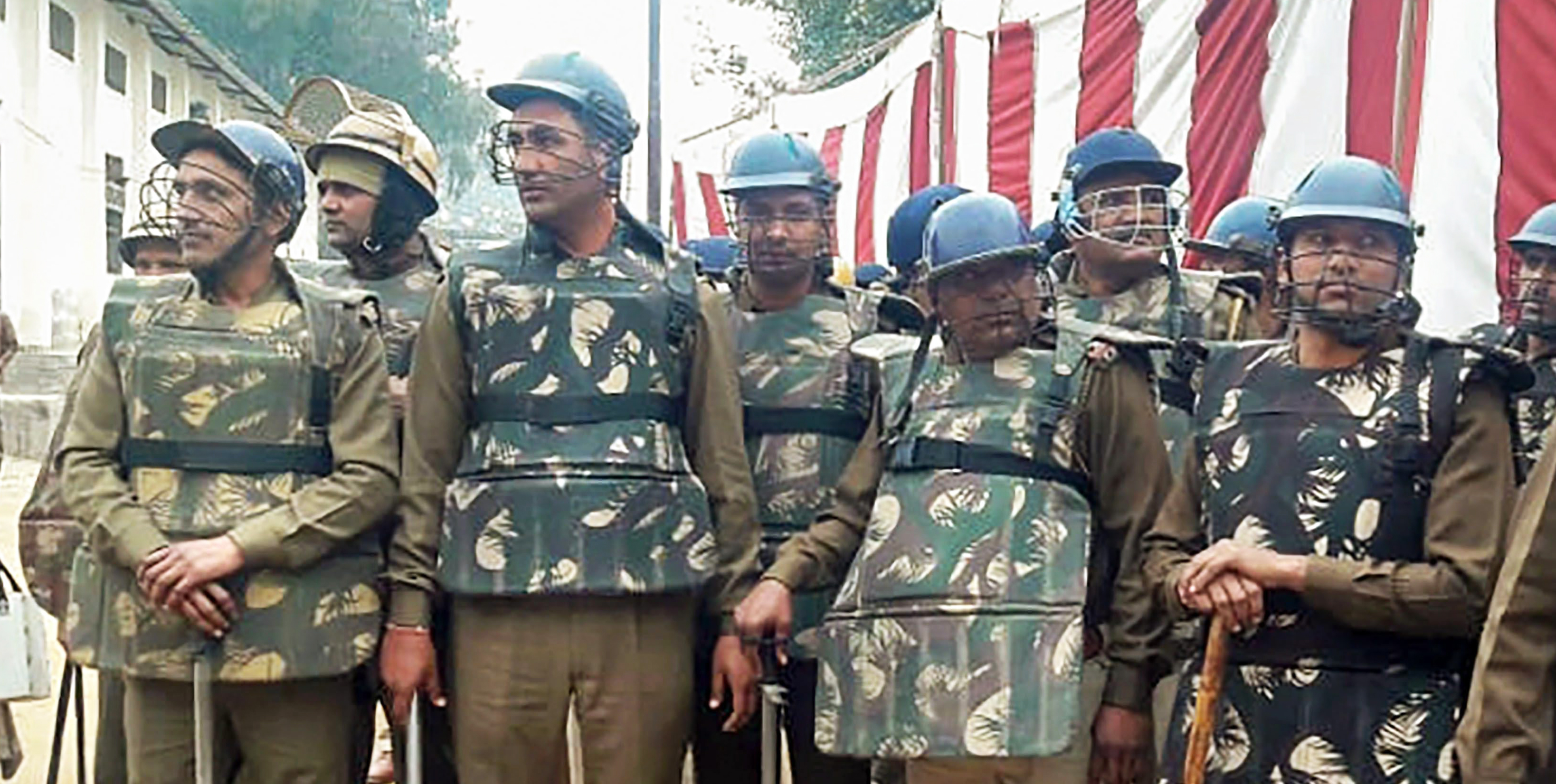 Security personnel stand guard during the counting of votes for by-election in Jind on Thursday, Jan. 31, 2018.