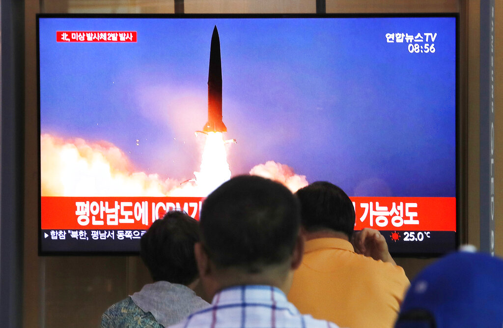 People watch television showing a file image of North Korea's missile launch during a news program at the Seoul Railway Station in Seoul, South Korea on Tuesday, September 10, 2019.