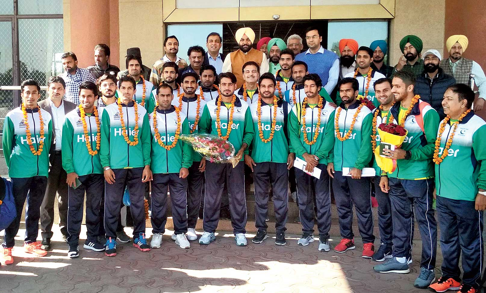 Pakistani hockey players enter India through the Wagha-Attari border on Saturday to take part in the Men's Hockey World Cup in Bhubaneswar.