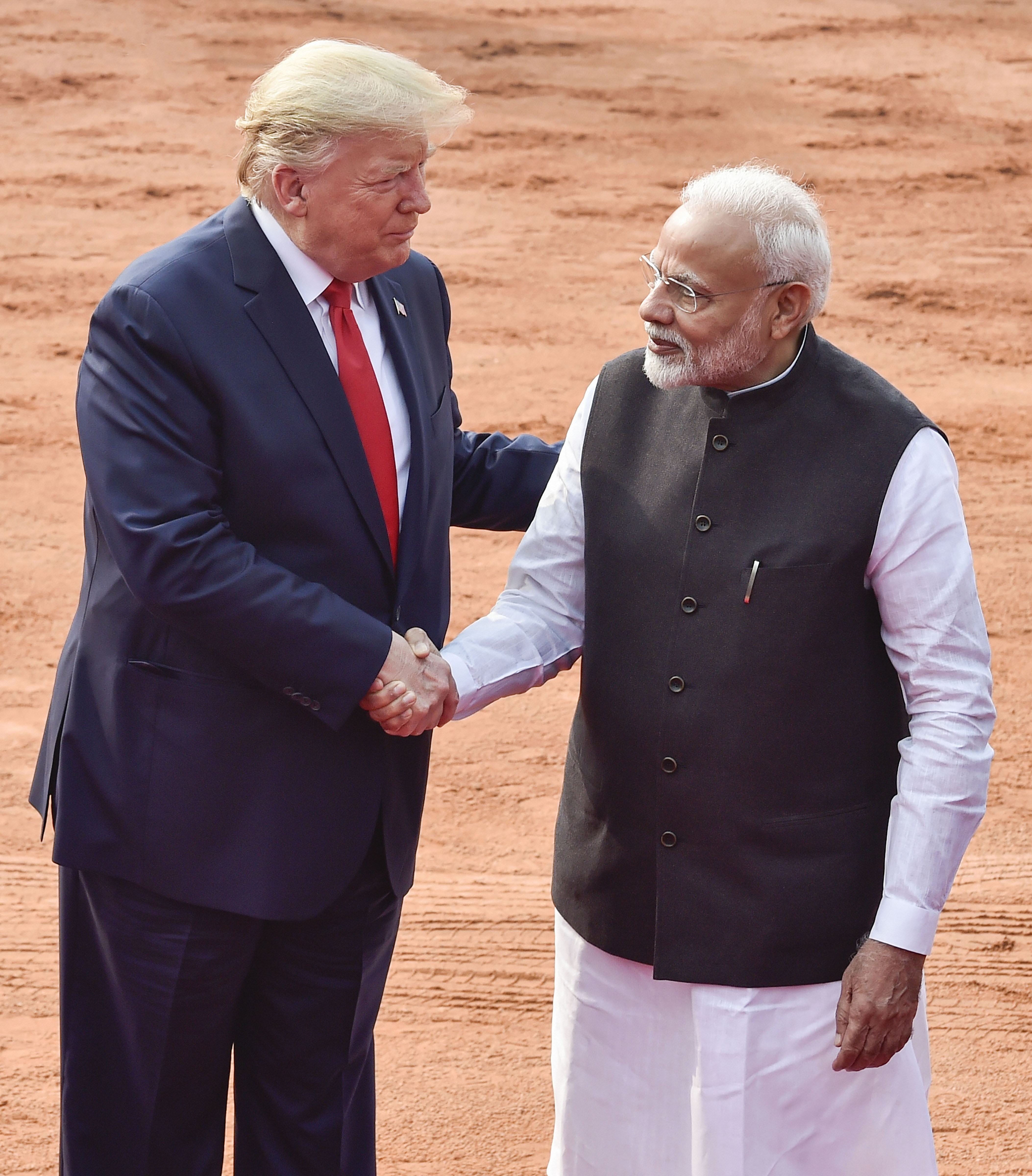 US President Donald Trump shakes hands with Prime Minister Narendra Modi during a ceremonial reception at Rashtrapati Bhavan in New Delhi, Tuesday, February 25, 2020