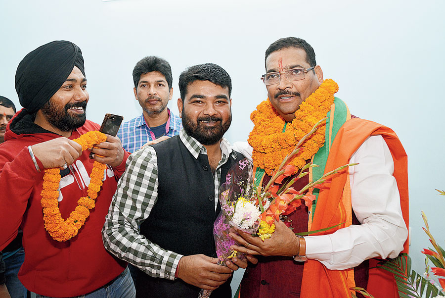 BJP workers welcome new state party president Deepak Prakash at his residence at Harmu in Ranchi on Tuesday.