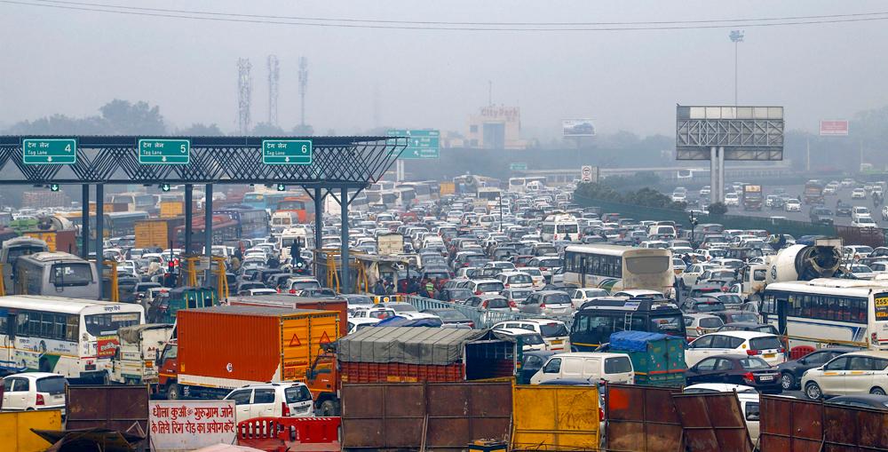 Traffic stands still on the Delhi-Gurgaon expressway in Gurgaon on Thursday