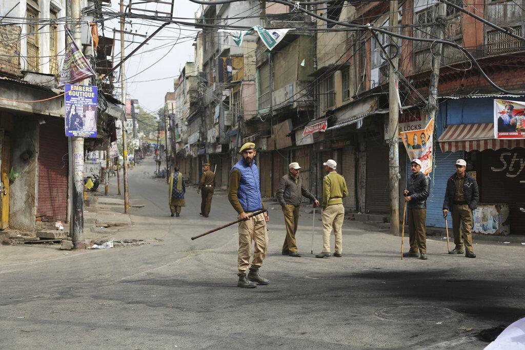 Policemen patrol during the third day of curfew in Jammu on Sunday.