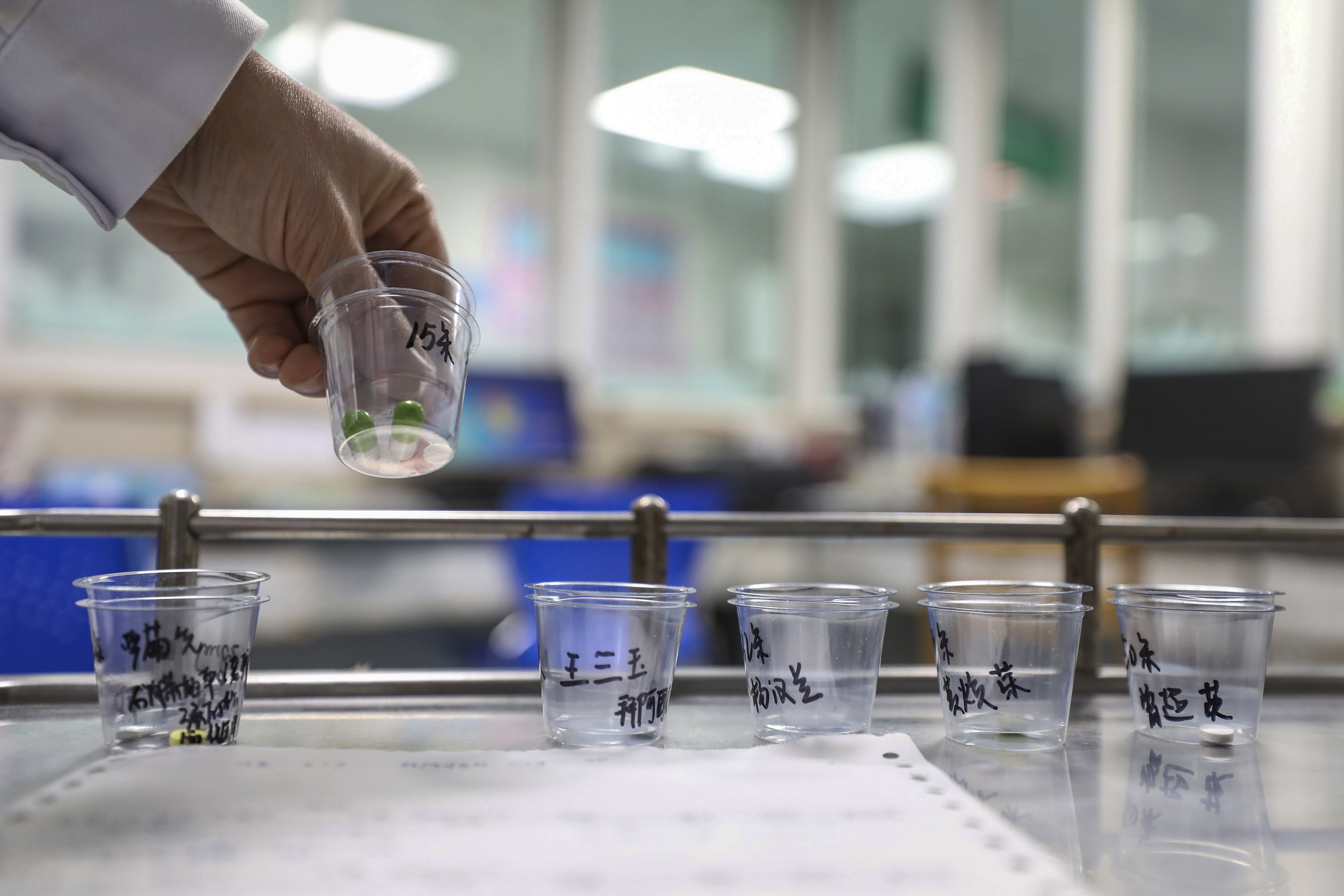 A nurse prepares medicines for patients at Jinyintan Hospital designated for new coronavirus infected patients, in Wuhan