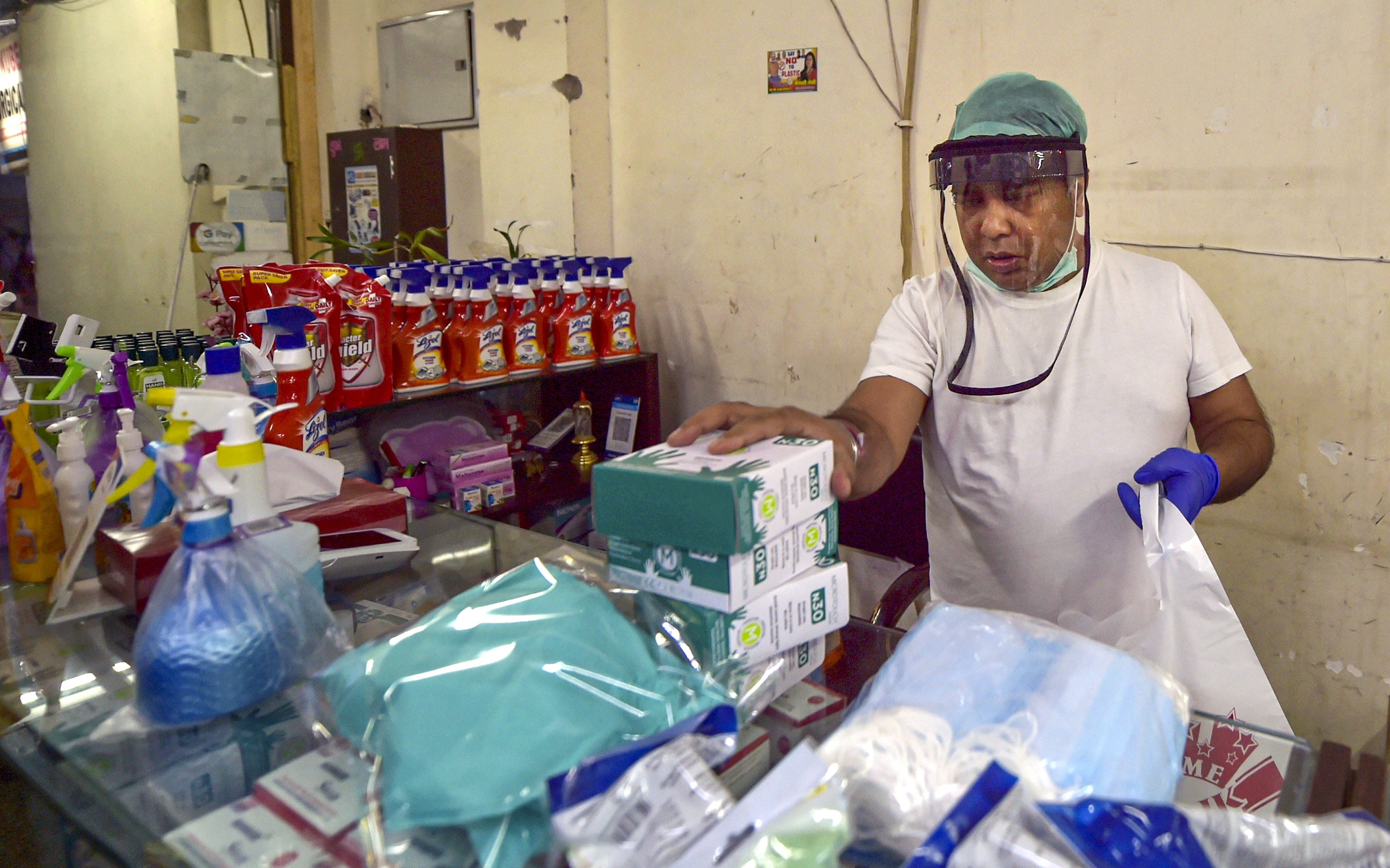 A Surgicals shop owner wears a protective face shield in wake of the coronavirus pandemic, during the nationwide lockdown, in New Delhi