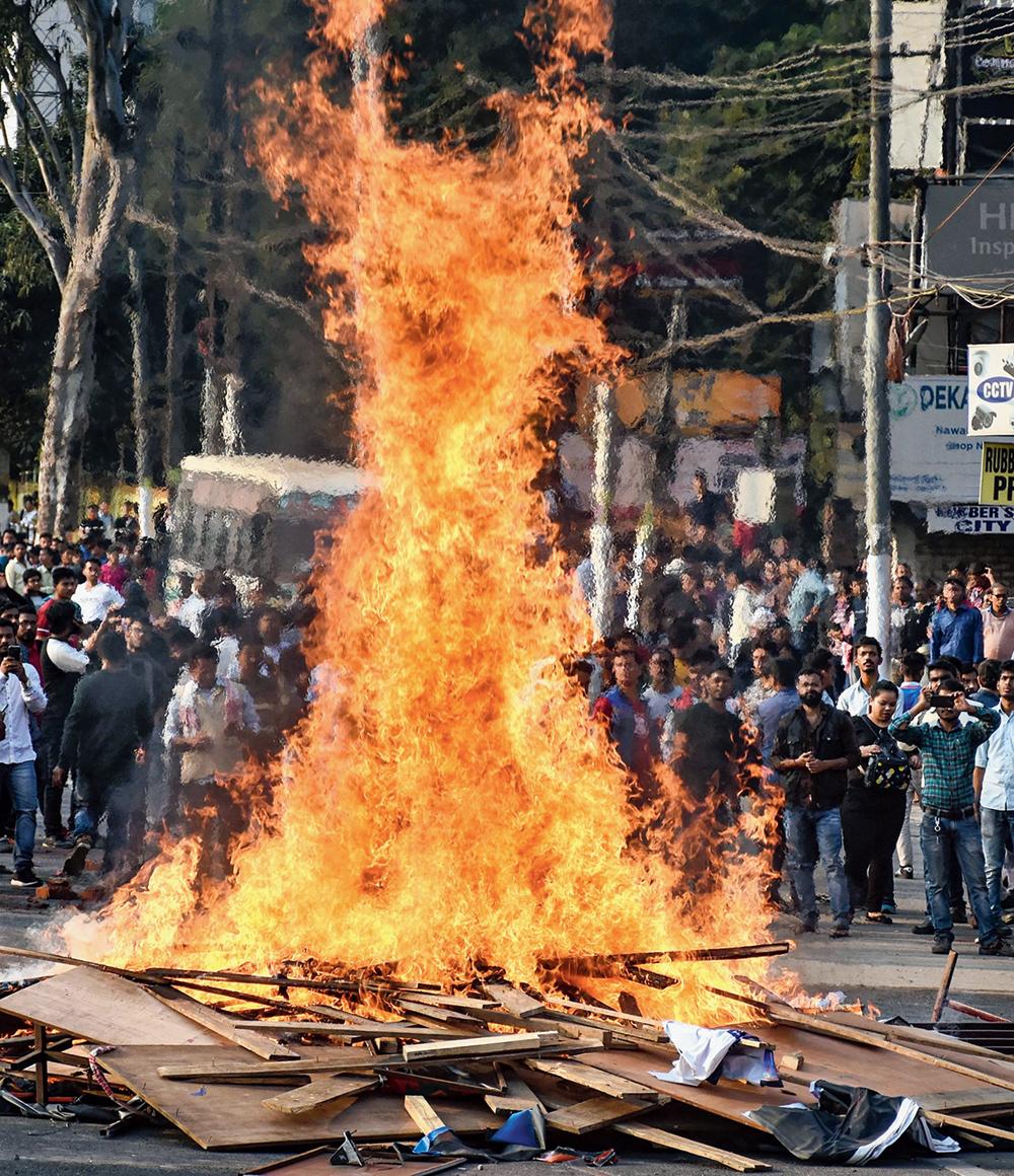 Protesters burn hoardings in Guwahati on Wednesday.