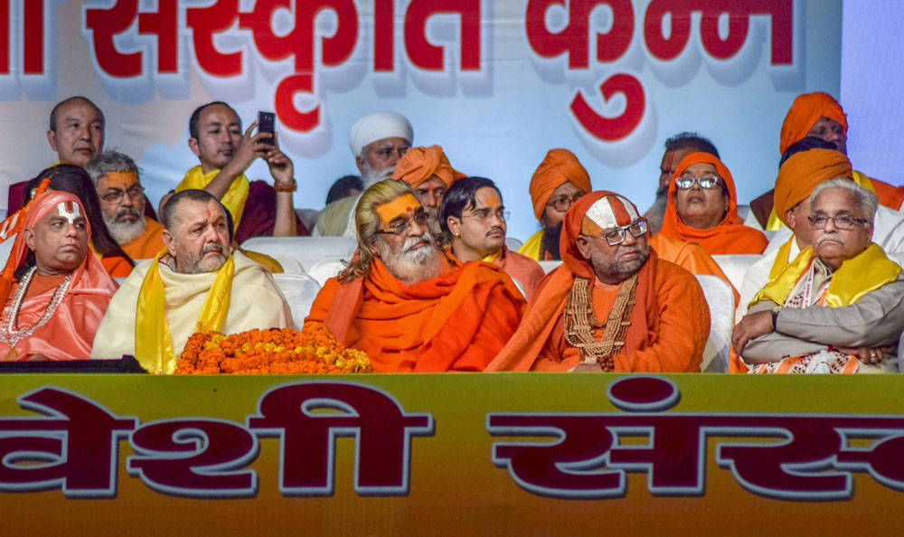 Senior RSS leader Suresh 'Bhaiyyaji' Joshi, Shankaracharya Vasudevanand Saraswati, Akhil Bharatiya Sant Samiti chief Jagadguru Hansdevacharya and others attend 'Dharm Sansad' session during Kumbh Mela 2019, in Allahabad, Wednesday, January 30, 2019