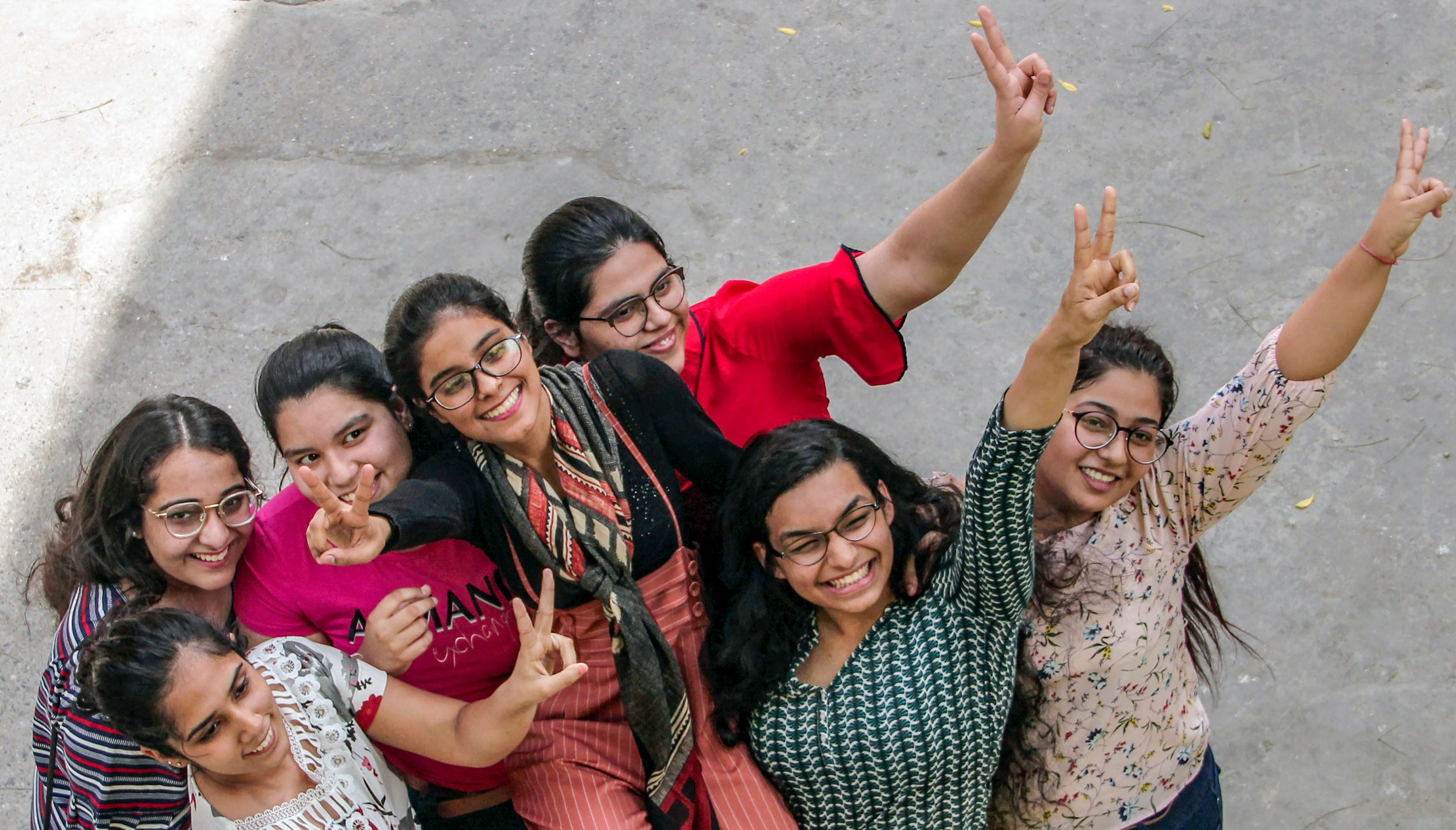 Students celebrate after the CBSE class XII results were declared, in New Delhi, on May 2, 2019.