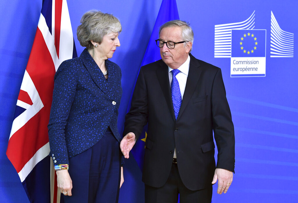 European Commission president Jean-Claude Juncker prepares to shake hands with British Prime Minister Theresa May before their meeting at the European Commission headquarters in Brussels on Thursday, February 7, 2019.