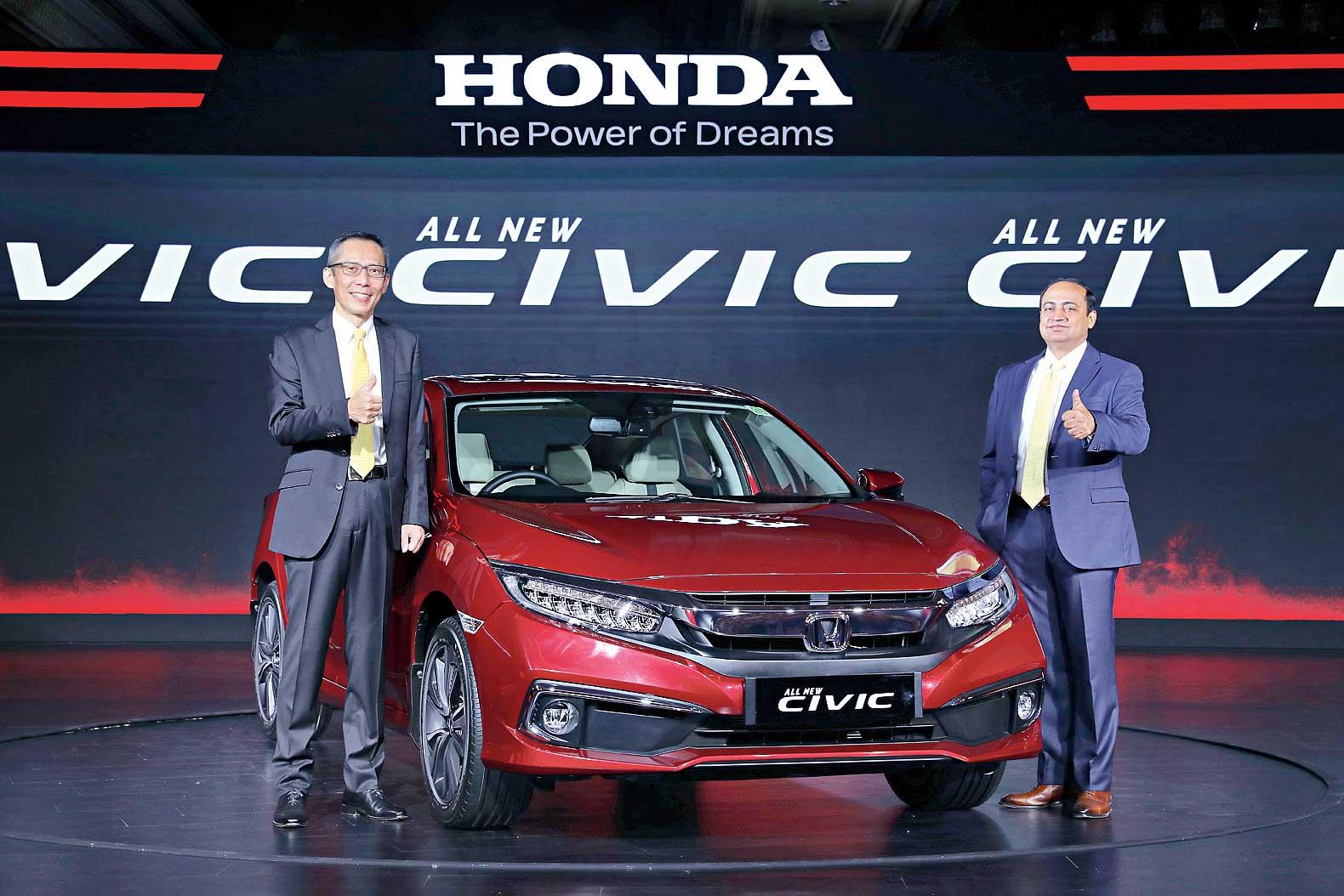 Gaku Nakanishi and Rajesh Goyal with the new Honda Civic in New Delhi on Thursday.