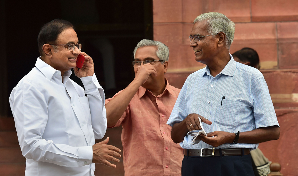 Congress MP P. Chidambaram and CPI MP D. Raja at Parliament during the Budget Session, in New Delhi, Friday, July 26, 2019.