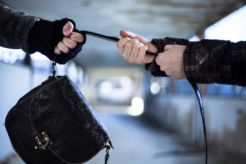 The 57-year-old had stepped out of her house, a five-minute drive from City Centre, and was walking across the street to her car when the men pulled her bag from behind and fled, an officer of the Bidhannagar commissionerate said.