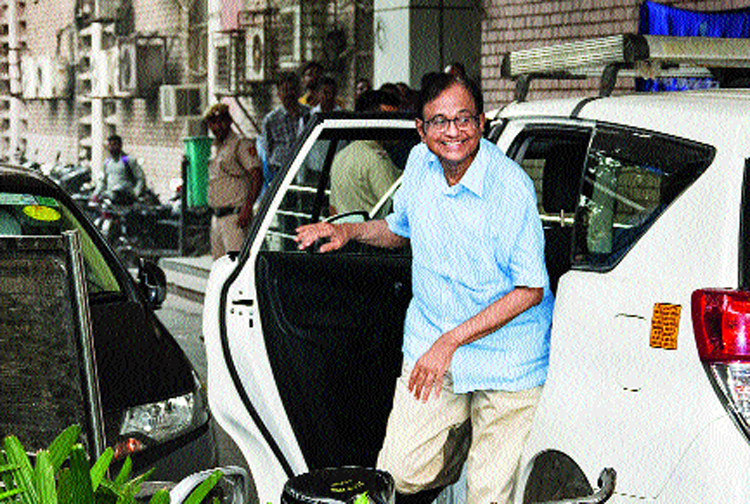 Chidambaram outside the ED office in New Delhi on Wednesday