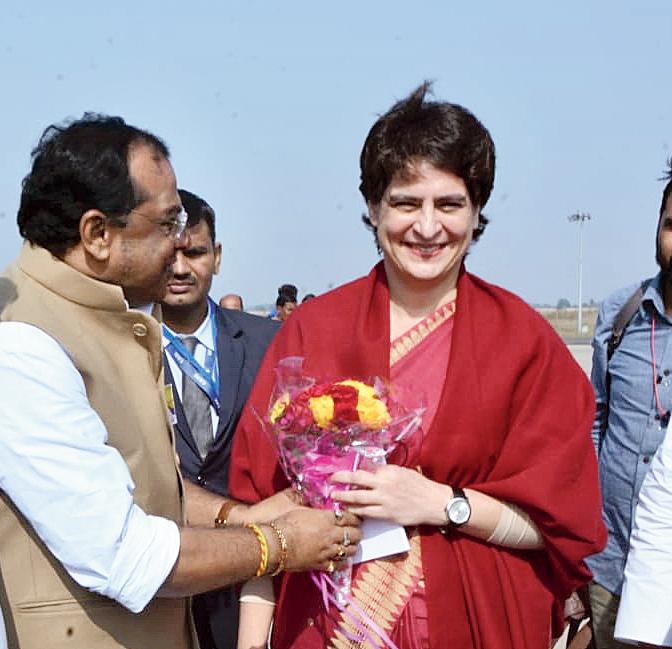 Tarun Roy (left) receives Priyanka at Andal airport on Wednesday.