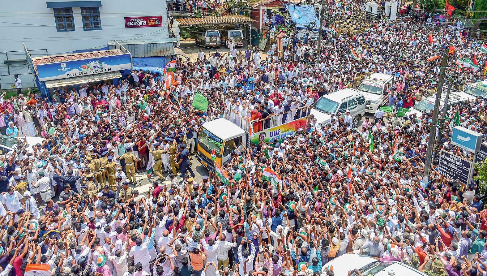 The cavalcade of Rahul and Priyanka winds its way through a crush of supporters in Wayanad, Kerala, on Thursday.