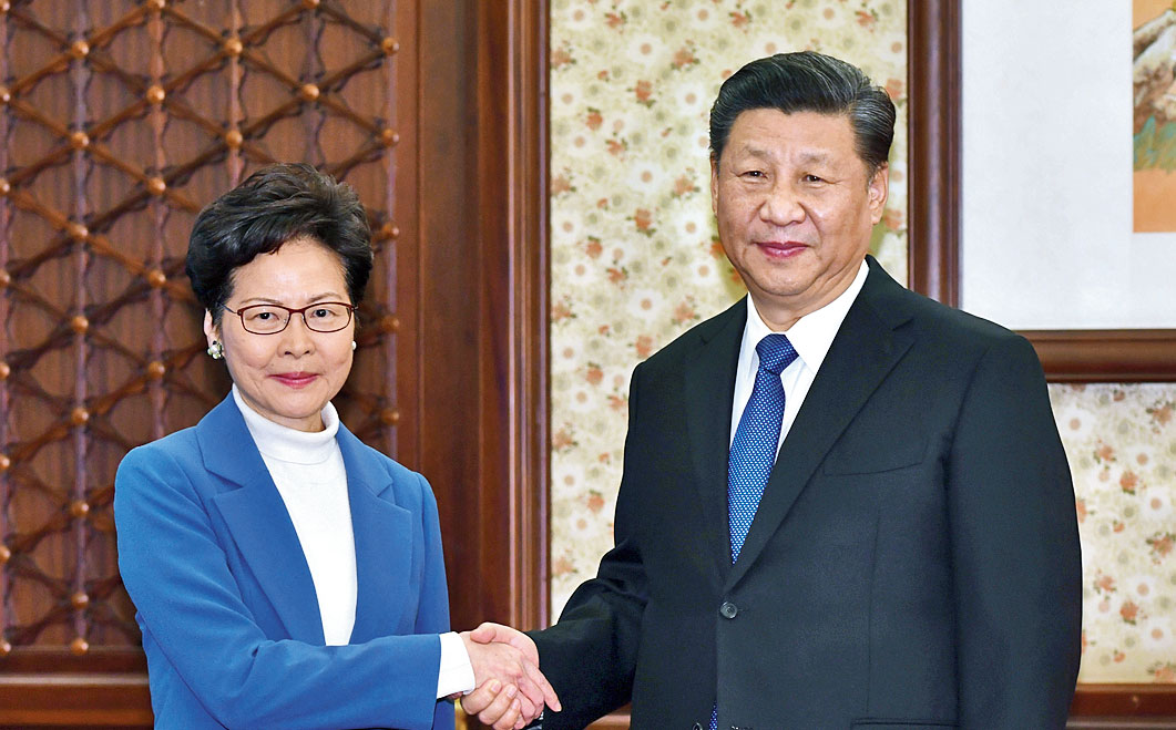 Hong Kong chief executive Carrie Lam with Chinese President Xi Jinping in Beijing on Monday